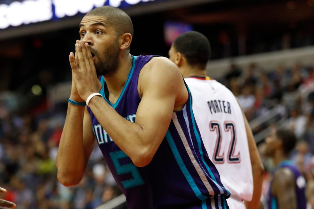 Apr 4, 2017; Washington, DC, USA; Charlotte Hornets guard Nicolas Batum (5) reacts to being called for a foul against the Washington Wizards in the third quarter at Verizon Center. The Wizards won 118-111. Mandatory Credit: Geoff Burke-USA TODAY Sports