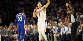 Dec 4, 2017; Philadelphia, PA, USA; Phoenix Suns guard Devin Booker (1) reacts to his three pointer in front of Philadelphia 76ers forward Robert Covington (33) during the fourth quarter at Wells Fargo Center. Mandatory Credit: Bill Streicher-USA TODAY Sports