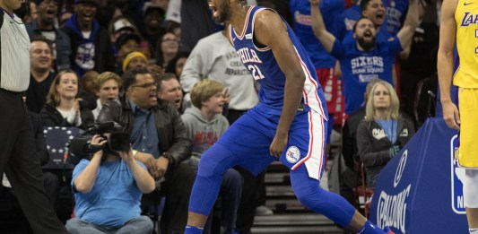 Dec 7, 2017; Philadelphia, PA, USA; Philadelphia 76ers center Joel Embiid (21) reacts to a score against the Los Angeles Lakers during the fourth quarter at Wells Fargo Center. Mandatory Credit: Bill Streicher-USA TODAY Sports