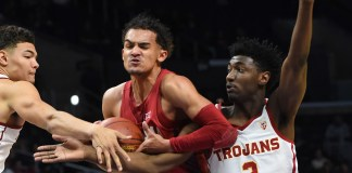 Dec 8, 2017; Los Angeles, CA, USA; USC Trojans guard Jordan Usher (1) and guard Jonah Mathews (2) defend Oklahoma Sooners guard Trae Young (11) as he drives to the basket in the first half of the game at Staples Center. Mandatory Credit: Jayne Kamin-Oncea-USA TODAY Sports