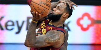 Dec 12, 2017; Cleveland, OH, USA; Cleveland Cavaliers forward LeBron James (23) is hit in the head by Atlanta Hawks forward Taurean Prince (12) while driving to the basket in the fourth quarter at Quicken Loans Arena. Mandatory Credit: David Richard-USA TODAY Sports
