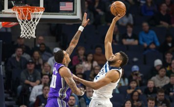 Dec 14, 2017; Minneapolis, MN, USA; Minnesota Timberwolves center Karl-Anthony Towns (32) shoots the ball over Sacramento Kings center Willie Cauley-Stein (00) in the first quarter at Target Center. Mandatory Credit: Jesse Johnson-USA TODAY Sports