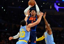 January 3, 2018; Los Angeles, CA, USA; Oklahoma City Thunder guard Russell Westbrook (0) shoots against Los Angeles Lakers guard Tyler Ennis (10) during the first half at Staples Center. Mandatory Credit: Gary A. Vasquez-USA TODAY Sports