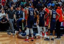 Jan 26, 2018; New Orleans, LA, USA; New Orleans Pelicans center DeMarcus Cousins (0) lays on the ground after suffering an apparent injury during the fourth quarter against the Houston Rockets at the Smoothie King Center. Pelicans defeated the Rockets 115-113. Mandatory Credit: Derick E. Hingle-USA TODAY Sports