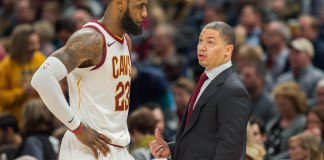 Jan 12, 2018; Indianapolis, IN, USA; Cleveland Cavaliers forward LeBron James (23) and head coach Tyronn Lue talk during a time out in the second half against the Indiana Pacers at Bankers Life Fieldhouse. Mandatory Credit: Trevor Ruszkowski-USA TODAY Sports