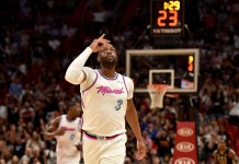 Feb 9, 2018; Miami, FL, USA; Miami Heat guard Dwyane Wade (3) reacts after making a three point basket against the Milwaukee Bucks during the first half of an NBA game at the American Airlines Arena. Mandatory Credit: Steve Mitchell-USA TODAY Sports