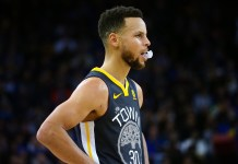 Feb 12, 2018; Oakland, CA, USA; Golden State Warriors guard Stephen Curry (30) with his mouthguard out between plays against the Phoenix Suns during the third quarter at Oracle Arena. Mandatory Credit: Kelley L Cox-USA TODAY Sports