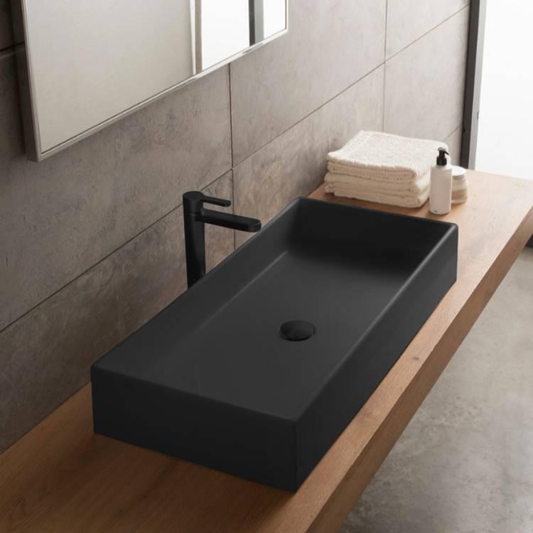 rectangular matte black vessel sink in ceramic