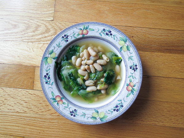 Escarole & Cannellini Soup - With garlic, escarole, and beans this quick and easy this soup recipe is perfect for lunch!