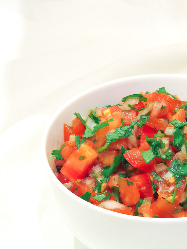 Pico de Gallo - Fresh flavours of tomatoes, serrano chillies, onion, coriander/cilantro, and lime make this pico de gallo super fun! Great for chips, fajitas, tacos, and burgers; and as a topping for chicken, steak and fish!