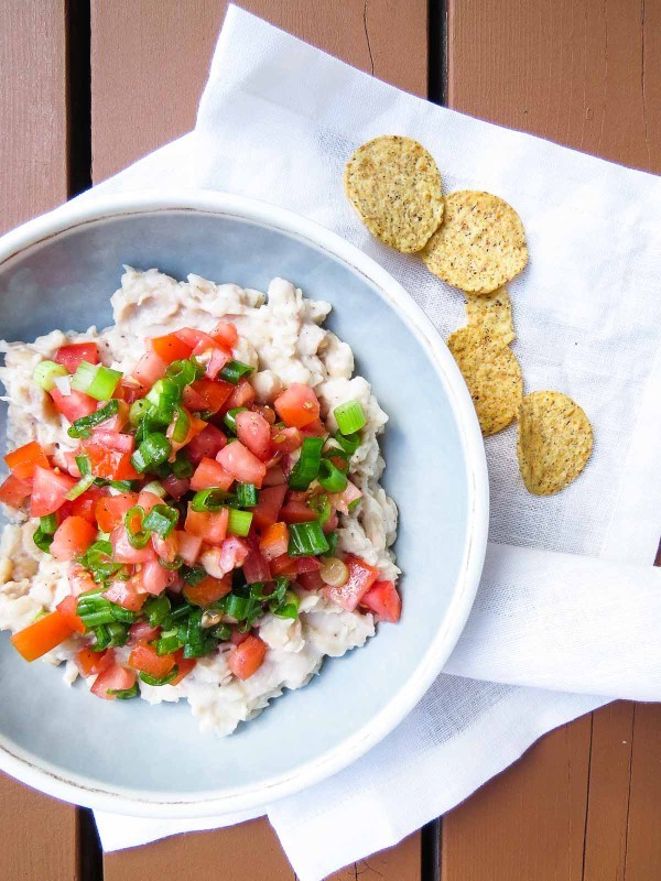 Healthy Tomato Scallion White Bean Dip - Hearty white cannellini beans mashed to a rustic hummus-like dip are topped with fresh tomatoes and scallions to make this yummy recipe! A perfect appetizer, snack, or lunch!