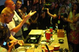 Tom Kerridge giving a demo to the sweltering room
