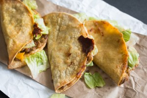 Delicious vegetarian tacos that taste just like Jack in the Box monster tacos! Made with lentils and beans, it's nutritious, delicious, and satisfies your naughty tooth!