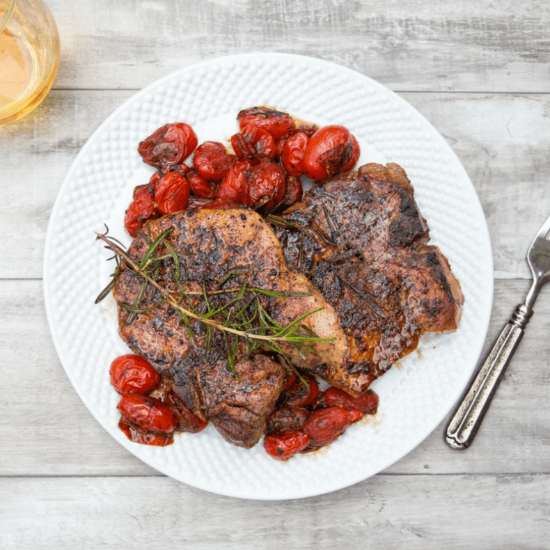 Unbelievably tender, juicy sous vide pork chops with blistered tomatoes. Easy to do with your sous vide stick or Instant Pot Ultra or Smart!