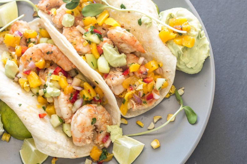 """Healthy grilled shrimp tacos with cucumber mango salsa and avocado """"cream"""" sauce is a great summer weeknight meal or your next taco bar!"""