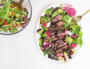 Grilled steak & spicy herb salad - bright greens and herbs, sweet grapes, and tender marinated steak.
