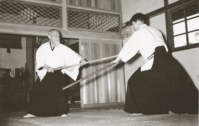 Aikidoka with a Jo