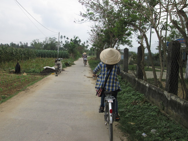 Our adorable Vietnamese tour guide on her bike