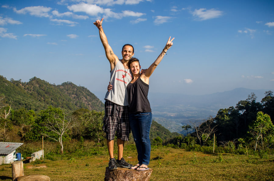 Adrian and Ashlie standing on top of a mountain in northern Thailand