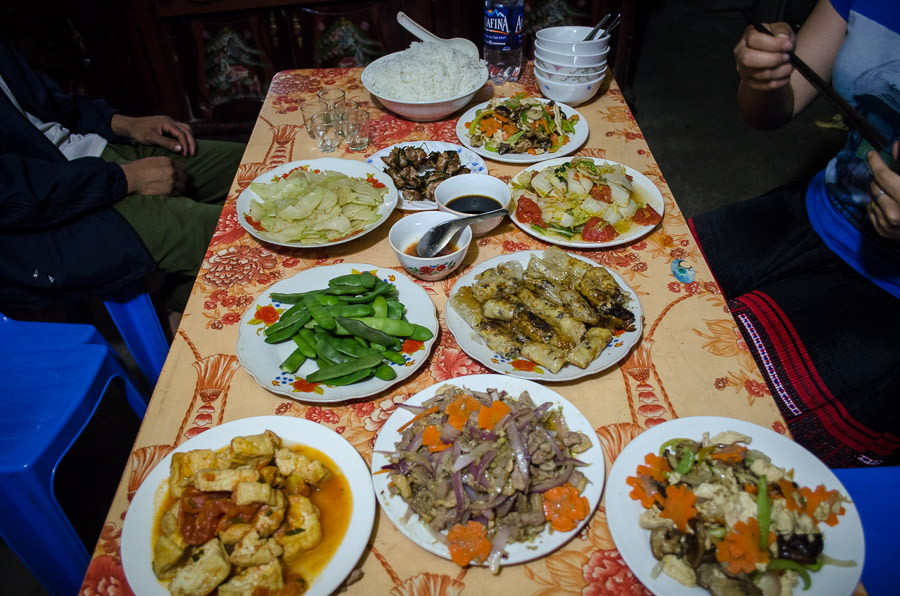 A table spread with food at a homestay in Ta Van Village, Vietnam.