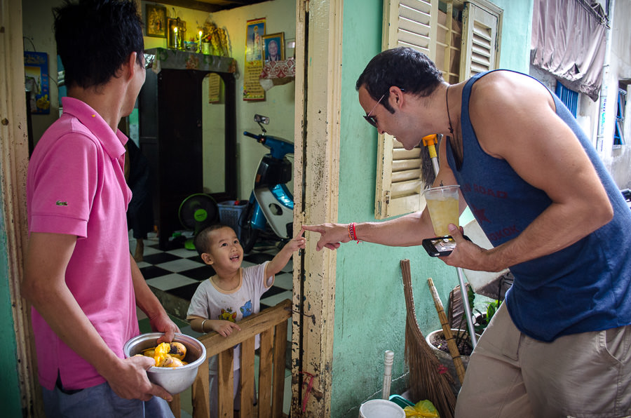 Adrian interacting with a young local boy in Ho Chi Minh City, Vietnam.