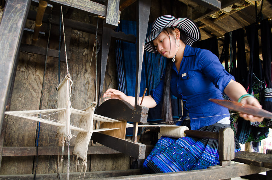 Mao showing us how to weave fabric