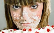 woman eating cream cake