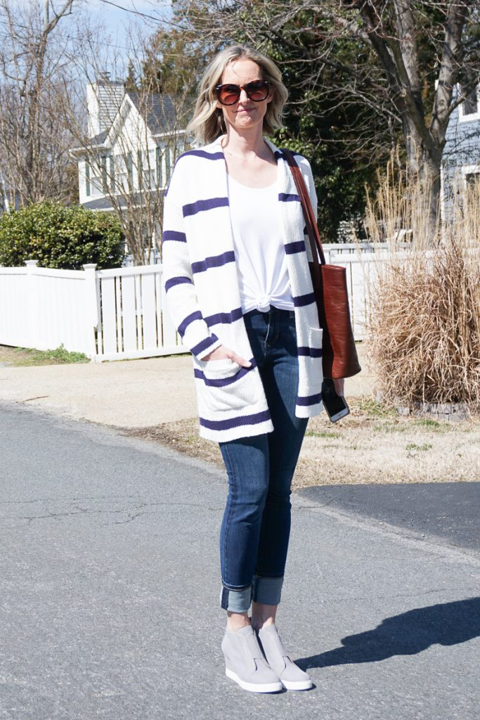 A CASUAL SPRING OUTFIT IDEA FOR EVERY DAY | I am sharing a cute and casual spring outfit idea for every day on the blog today. The striped cardigan is great for layering and the jeans are the most flattering and comfy as can be. The wedge sneakers are cute and really complete the outfit. A great mom uniform. #springoutfit #outfitidea #casualoutfit #stripedcardigan #wedgesneakers #over40style #over40
