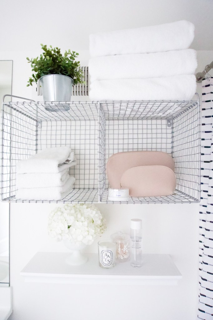 GUEST BATHROOM MAKEOVER ON A BUDGET || Sharing quick and easy tips to update your bathroom on a budget, including fresh paint, new fixtures and hardware and some budget friendly target finds to make the space warm and welcoming for our guests. #budgetmakeover #smallbathroom #makeover #diy #budgetfriendly #bathroomrefresh