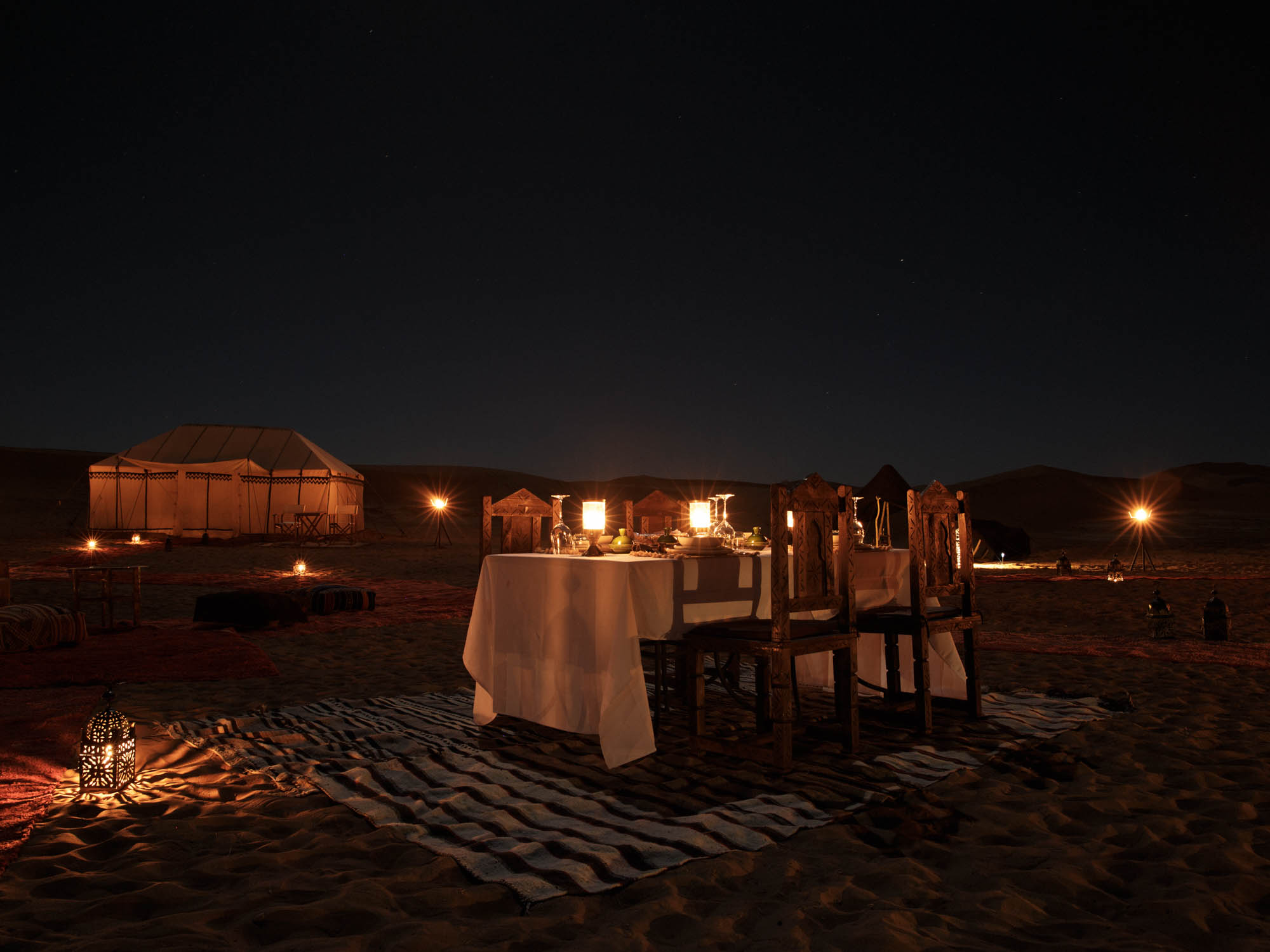 Romantic Candle Lit Night Time Dining at Desert Camp Morocco