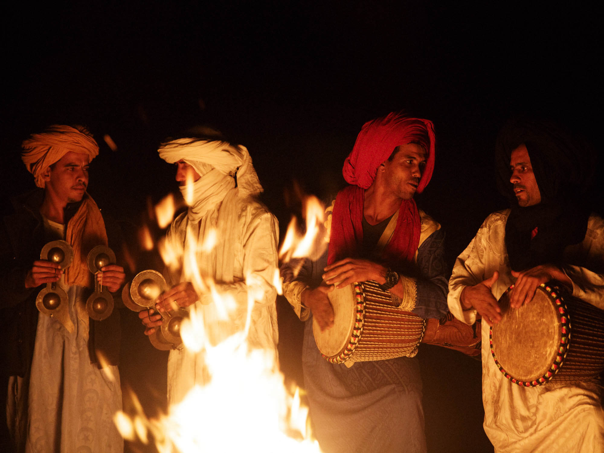 Moroccan Folk Musicians Playing Traditional Krakebs, iron castanets and Goat Skin Bongos.