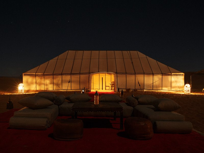 Luxury Furnishings in the Evening in Romantic Setting at Desert Camp