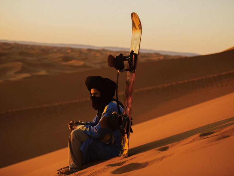 Berber Activities Guide with Sandboarding Equipment