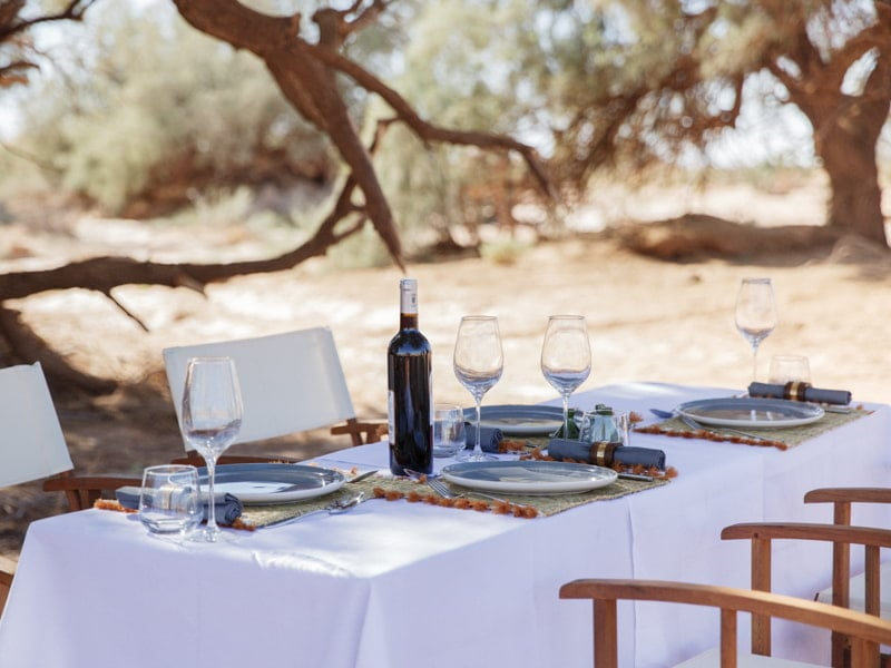 Bottle of Wine and Glasses Set at Beldi Dining Table
