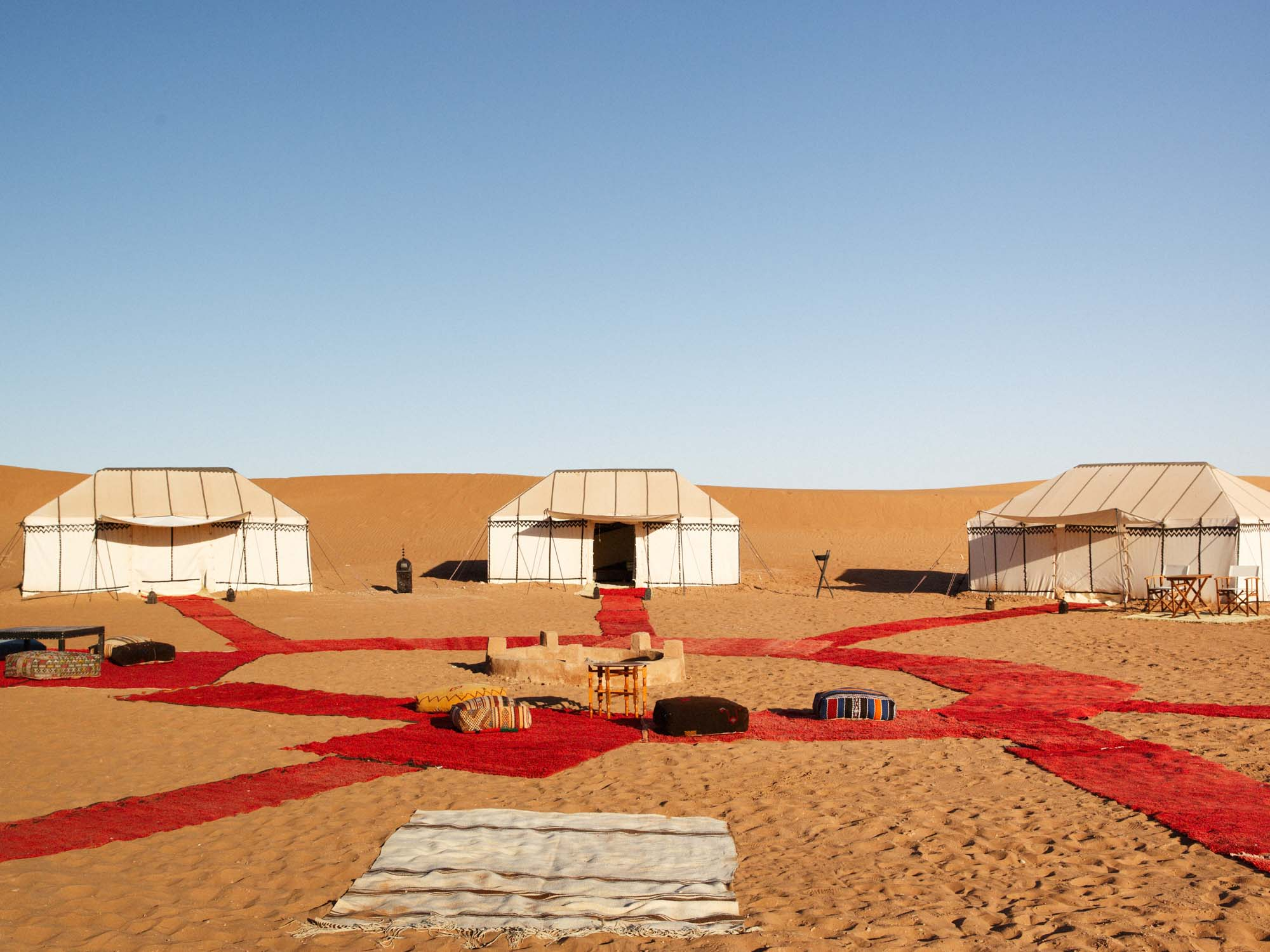 Red Carpets Around the Firepit in Sahara Desert at Nubia Camp Morocco