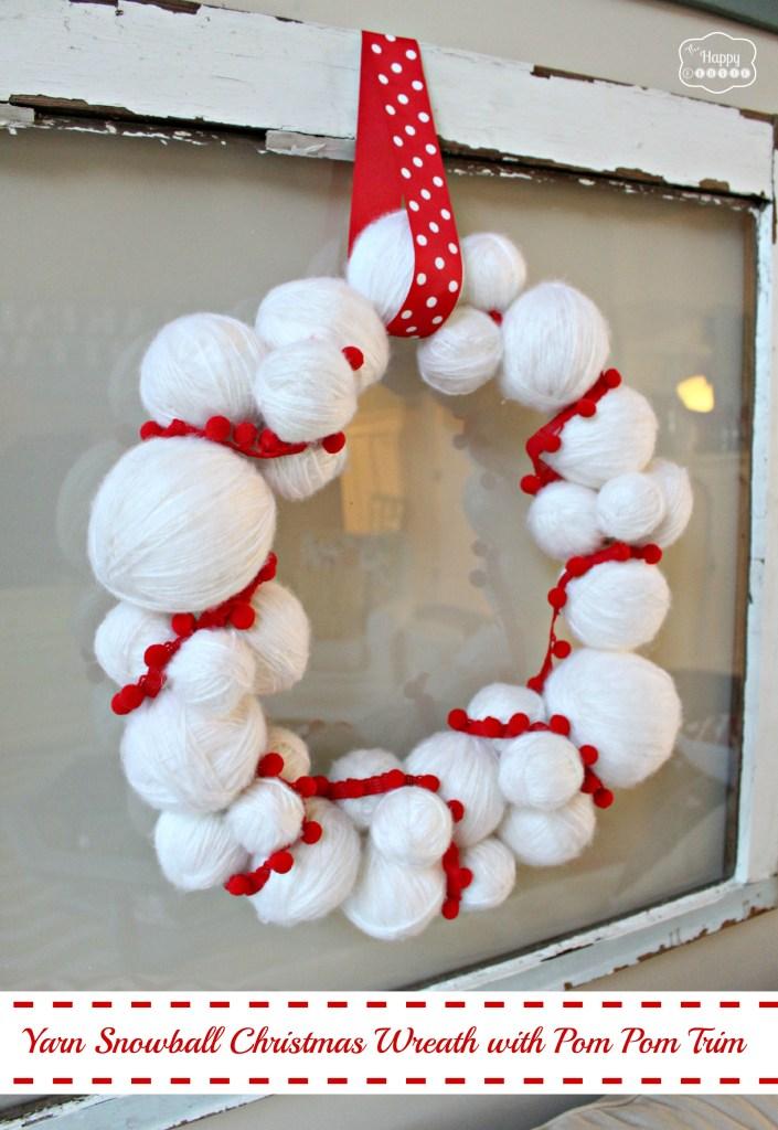 yarn-snowball-christmas-wreath-with-pom-pom-trim-at-thehappyhousie