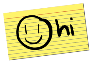 smiley face and 'hi' written on yellow index card