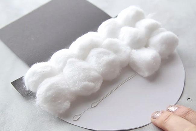 Glue Cotton Balls on Snowman