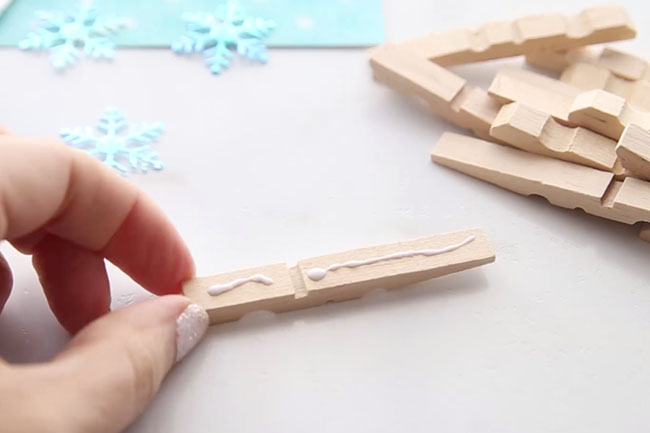Glue Clothespins Together for Snowflakes
