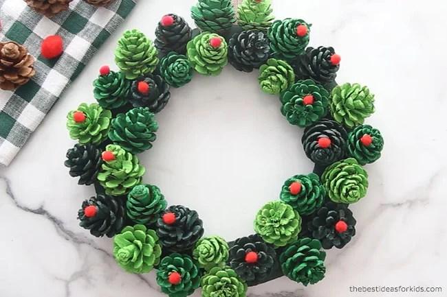 Glue Pom Poms to Pine cone Wreath