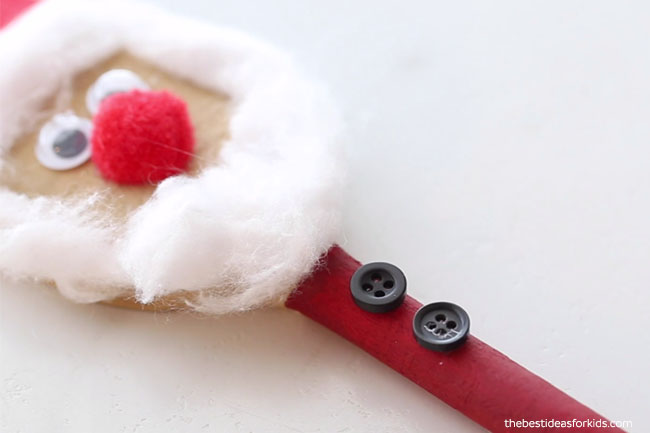 Glue on Buttons to Santa