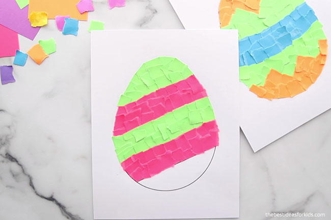 Keep gluing paper strips to egg template