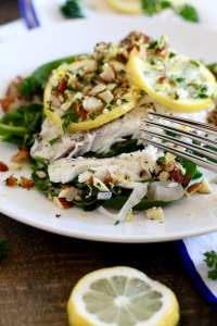 Barramundi in Parchment with Lemons, Dates and Toasted Almonds