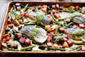 Barramundi Sheet Pan Dinner with Spring Vegetables and Pesto