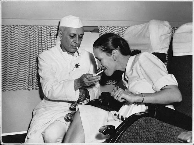 Prime Minister Nehru with Mrs. Simon, the wife ofthe British Deputy High Commissioner, on board the first BOAC flight in India.