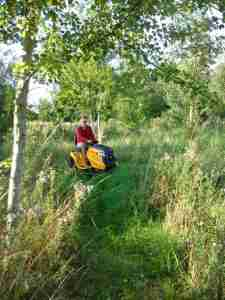 Alexis on his tractor-lawn mower
