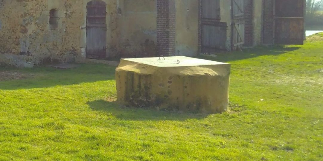 The well in front of Outhouse 1