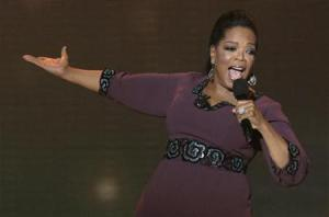 """Oprah Winfrey gestures during the taping of """"Oprah's Surprise Spectacular"""" in Chicago"""