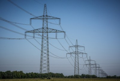 several power transmission lines against a clear blue sky background