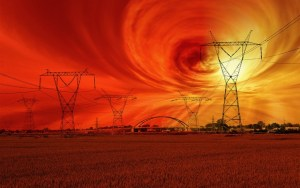 Image of space weather in background of electricity transmission lines
